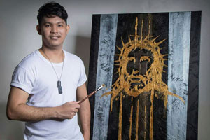 Mario Subeldia, Taiwan's first Filipino migrant artist, poses with his work. Subeldia left Luzon in the Philippines to work in Taiwan, where he discovered his talent, passion, and future as an artist.