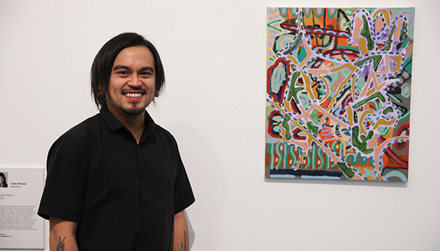 Artist Patrick Cruz with his award-winning work Time allergy