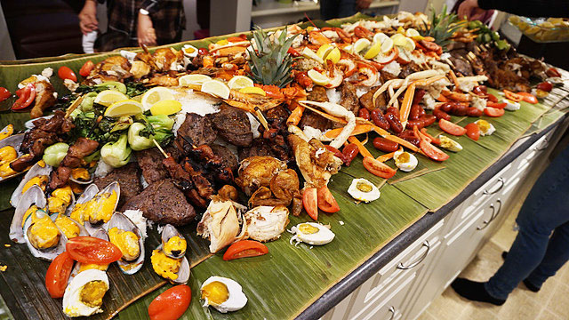 Kamayan or eating with hands means literally sharing a table with friends for a feast.